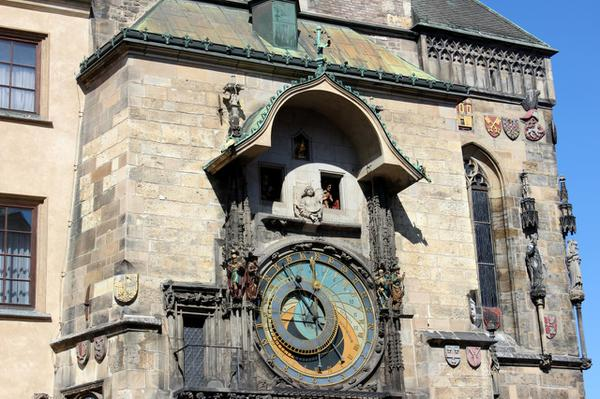 The clock in the old town hall is a very popular sight among tourists.