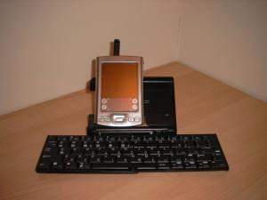 My Palm Tungsten E2 sat in the cradle built in to the palm universal wireless keyboard.